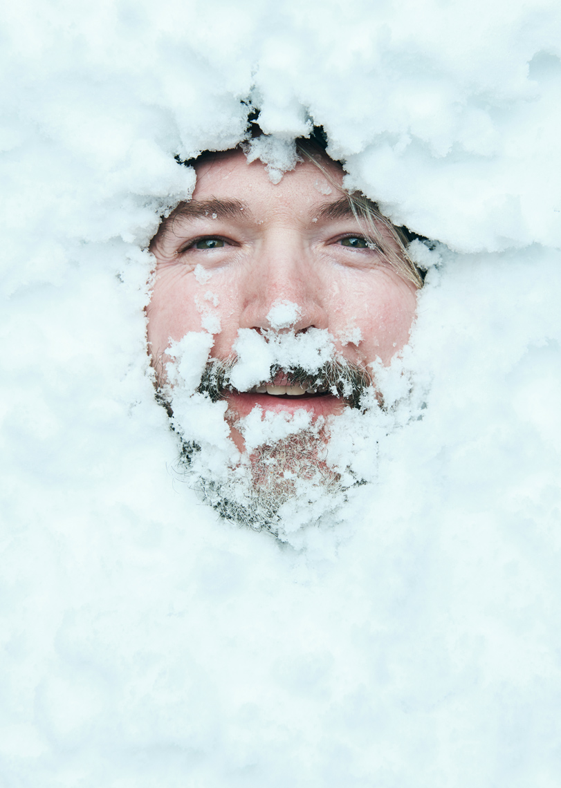 Man Buried in snow photo by Zach Kracht